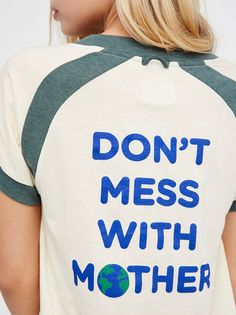 "Don't Mess With Mother Tee | American made retro-inspired tee featuring a back graphic that says ""Don't mess with mother"".    * Super soft   * Short sleeves   * V-neckline   * Contrast raglan seam detailing   * Semi-sheer"