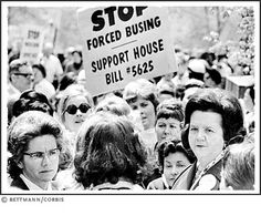 Louise Day Hicks (lower right) joined a large gathering of demonstrators outside the State House in Boston to protest busing of school children and to repeal the state's racial imbalance law, May 2, 1973. Hicks had long maintained that public schools in Boston were neither separate nor unequal.