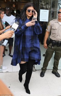 Fashion star: Kylie Jenner, 18, was photographed wearing a$1,475 blue and black buffalo plaid shirtdress by the New York-based label Houghton last month, which led to it selling out after it was put back into production