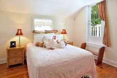 Bedroom is delightfully decorated in playful celebration of the infamous Key West chickens. Hardly a coup, a queen size bed, with a luxurious chenille bedspread adorned with stuffed-animal chenille chickens to match, are sure to make you chuckle. Seaport Treasure Estate | 6 Bedroom Monthly Vacation Rental