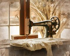 Old Sewing Machine Fine Art by Terry Fleckney. I love the light in the room of the photo.