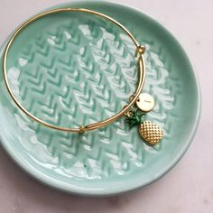 An adorable pineapple charm and hand stamped brass initial tag hang from an adjustable bangle that is perfect for stacking!  Please leave your desired initial in the message to seller when you check out.  ♡ QUESTIONS? Send me a convo by clicking contact the shop owner below this listing. My name is Leslie, and I love to answer your questions and accommodate requests!  ♡ KEEP SHOPPING! http://www.etsy.com/shop/leslie23  ♡ PACKAGING: All orders come with my super cute custom packaging. You wil...
