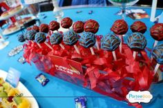 Chocolate covered lollipops with web patterns, designed and made by ParteeBoo for a Spiderman theme birthday party