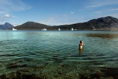 """It is not uncommon for Greenlanders to take a dip among icebergs in half-frozen fjords, but more appealing are the country's hot springs pools, such as this one near Alluuitsup Paa on the uninhabited island of [b]Uunartoq[/b], in southern [b][link url=""""http://www.greenland.com""""]Greenland[/link][/b]. The water temperature gets as high as 38ºC."""