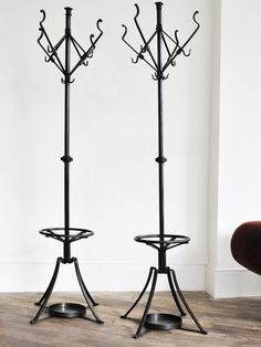 pair of coat stands by august kitschelt rose uniacke