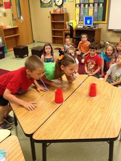 Tunstall's Teaching Tidbits: Our Last Day in Pictures You have to blow the cup off the other side of table only using a straw. (modification is lean on the table if needed :) )