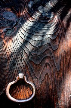 Aged with beauty this old wood door...