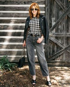 Check top, moto jacket, jeans and sandals | Photo shared by Cathy, @themiddlepageblog | For more style inspiration visit 40plusstyle.com