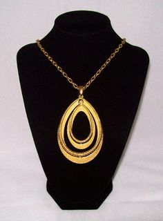 Crown Trifari Necklace - A Pendant of Golden Spiral Edged Interlocked Ovals on an Opera Length Chain, Vintage 1960s - offered by Annabelle's Cabinet, $78.00