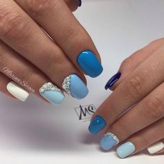 All Hues of Blue Studded Nail Art Design. Grab all your shades of blue, white and some studs, to get this amazing yet simple to do nail art design.