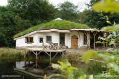 Charlie's home is designed from the natural resources available on the land using stone, roundwood, straw bales, clay, turf and lime.