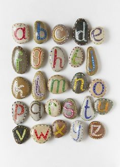After T paints rocks as craft, write letters on then to use for alphabet hide and seek.