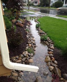 <3 River rock retaining wall/ river. Great way to direct water away from your foundation!