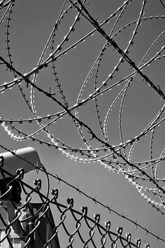 Download this free photo from Pexels at https://www.pexels.com/photo/abstract-barbed-wire-black-white-black-and-white-274886/ #black-and-white #camera #silhouette