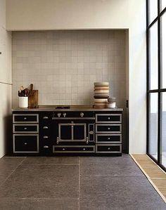 Vincent Van Duysen., black stove, grey tile, dark grey floors