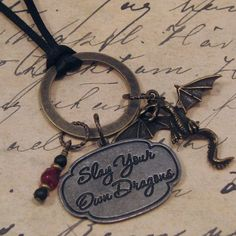 Slay Your Own Dragons Charm Necklace on by CirclesOfStoneShop