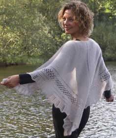 Karen Noe Design - The shawl is constructed like old Danish peasant shawls, which were intended for warmth, not finery. Most of these shawls were knitted in triangular shapes, and worked in garter stitch enlivened by a few borders in lace knitting. The shawl is fashioned to fall nicely over the shoulders of the wearer.