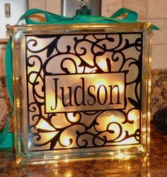No real directions but it looks like a Glass Block, Christmas lights, ribbon, and Cricut or similar cutout.  Very nice, would make a great gift.