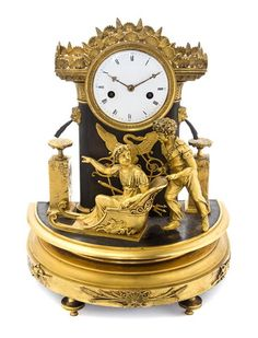 An Empire Style Gilt Bronze Mounted Mantel Clock Height 15 inches.