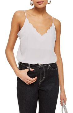 Free shipping and returns on Topshop Scallop Camisole at Nordstrom.com. Pretty scalloped edges delight the neckline of this body-skimming cami styled with slinky spaghetti straps and a low-dipping back.