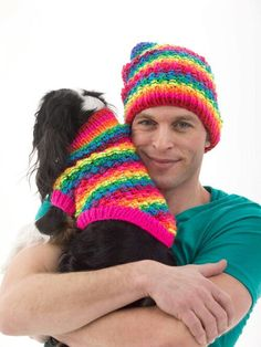Matching knitted hat and doggy sweater. Love the bright colors.