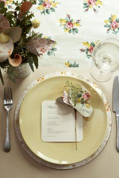 Wallpaper was used to make the placemat, flowers in the vase, and the flower name card!