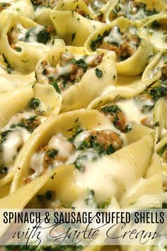 Sausage and Spinach Stuffed Shells with Garlic Cream Sauce | A rustic, simple recipe for stuffed pasta shells with Italian sausage, spinach and mozzarella stopped with an easy garlic cream sauce.