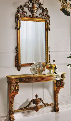 """47"""" W X 17"""" D X 34"""" H Hand carved wall mounted console in citronier finish with gold leaf accents. Yellow Reale marble topantique gold leaf with Bordeaux. CAP-208-S Mirror 33""""W X 59""""H"""