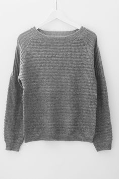 Chunky knit pullover sweater with a slightly loose fit and ribbed knit texture…