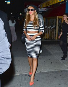 How to Instantly Upgrade Your Outfit: Pull a Beyoncé  Bey paired horizontal black and white-striped crop top with hot orange pointy-toe pumps. She looks amazing!