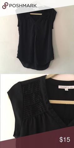 Cute Black V-neck Top Pre-loved and in great condition. Very professional. The material is perfect for spring and summer. Daniel Rainn Tops Blouses