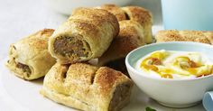 Give the classic sausage rolls a sophisticated twist with curry paste and mango yoghurt dip.