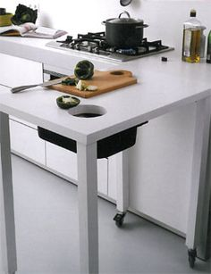 This I am going to make! A small table put on wheels and a hole in it. How smart is this?!