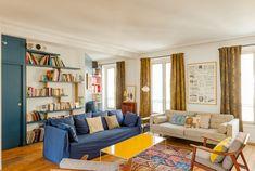 Salon au look 50's dans un appartement parisien réaménagé par l'agence d'architecture Maéma.