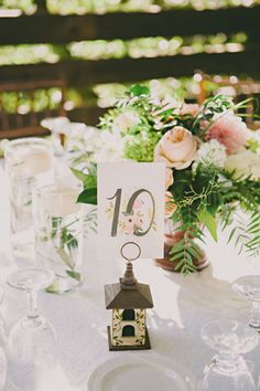 love these table numbers http://www.weddingchicks.com/2014/02/05/calamigos-ranch-wedding-dave-richards-photography/