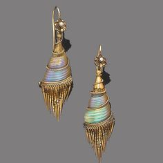 A pair of shell and gold earrings, circa 1870 Each floral surmount with half-pearl detail, to a vertically set iridescent seashell within a scrolling ropetwist frame and an articulated tassel of polished tapering links, length 5.8cm., fitted case