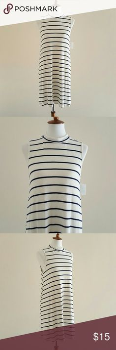 White and Blue Striped Sleeveless Dress White and blue striped sleeveless dress.Trapeze style. Sleeveless. Lined. Casual and confortable!! 96% Rayon 4% Spandex. Laying flat chest measures 19.5'. Total length of dress is 36'. mm mm  Dresses Mini