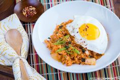Kimchi Fried Rice  recipe - Spicy and tangy kimchi fried rice topped with a fried egg, sesame seeds, Korean seaweed, and scallion. Simply marvelous!