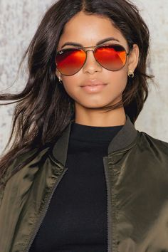 Reflect your style with Ray-Ban Aviator 6 Flash lens sunglasses, one of the most iconic sunglass models in the world. It has a unique teardrop shape and orange flash lens. It´s easy to upgrade your every outfit with these sunglasses. #nakdfashion