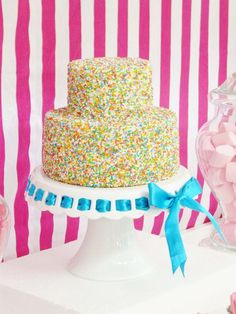 The easiest way to decorate a cake- cover it in sprinkles!  So cute and simple!