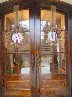 Initial wreaths w/ Wooden Letters (paint letters color of shower/wedding theme). Add Baby's Breath & Burlap ribbon (All from Hobby Lobby)