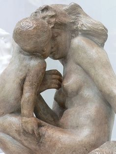 AUGUSTE RODIN Young Mother with Child. Sculpture.  This beautiful sculpture was completed in 1885.