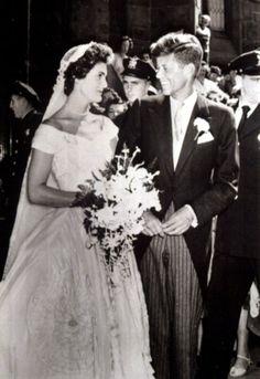 Jacqueline Bouvier marries John F Kennedy, 1953 Jacqueline Bouvier's wedding dress was designed by African-American fashion designer Ann Lowe.