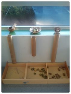 Sorting natural materials - love the idea of 'posting' through a tube...adds extra fun to sorting...