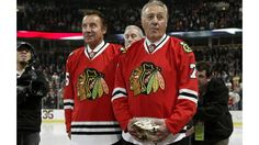 CHICAGO, IL - MARCH 19: Former Chicago Blackhawks goalie Tony Esposito stands next to his brother Phil Esposito during a pre-game ceremony in his honor on March 19, 2008 at the United Center in Chicago, Illinois. (Photo by Bill Smith/NHLI via Getty Images)