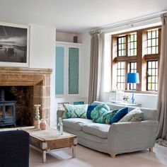 Exterior | Step inside this 15th century West Sussex home | housetohome.co.uk#results Long table against the window for lamp and vase, couch in front of the table.