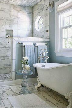 Double Towel Bar & Frameless Shower Enclosure.