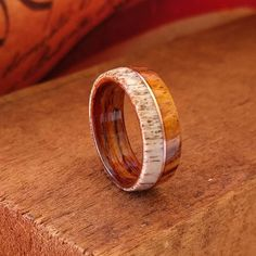 The ring you purchase will be similar to the one photographed, although due to the natural variations in the wood's grain, no two rings will be exactly alike. Every ring is one of a kind! Each ring will be handmade to the dimensions that you select.  ............................................