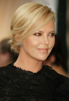 """charlize theron as dr. greene (ana's ob/gyn) - """"dr. greene is tall, blonde, and immaculate... she's like an identikit model—another stepford blonde. her long hair is swept up in an elegant chignon. she must be in her early forties."""" - fifty shades of grey"""