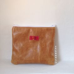 Handmade leather pouch with red gingham cotton lining. Made in Italy by IT TAKES TWO